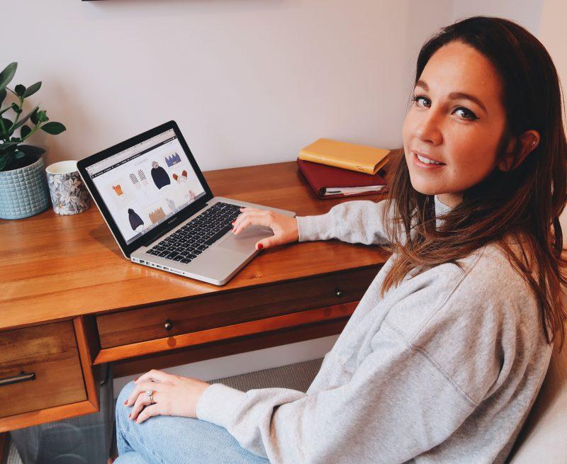 Charlotte Kewley sat at a desk