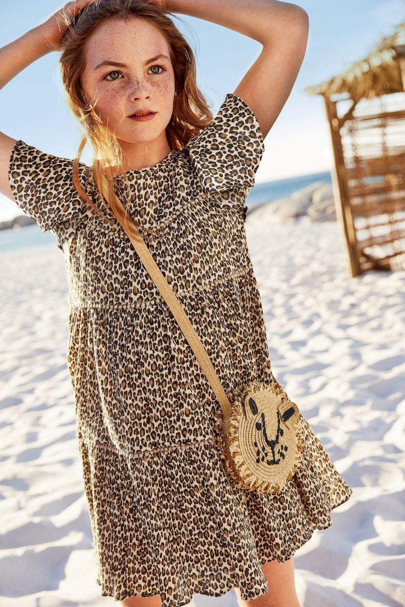 girl-on-beach-leopard-dress