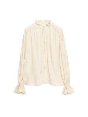 Cream ruffle neck-tie blouse