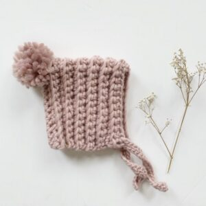Chunky dusty pink knit baby bonnet