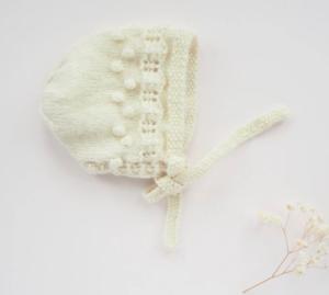 Cream knit baby bonnet